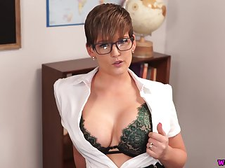 Nerdy office lady Hannah Brooks stands on knees to wank a fake cock
