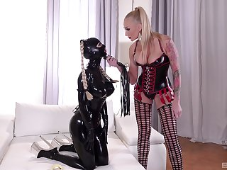 Mistress plays dominant anent slave generalized dressed in latex get-up