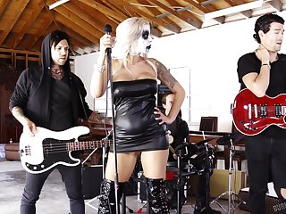 Busty female roil singer Nina Elle is fucked by duo brutal guitarists