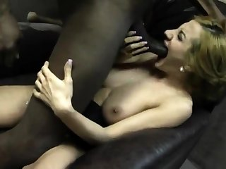 Blonde bitch with obese boobs fucking two cocks