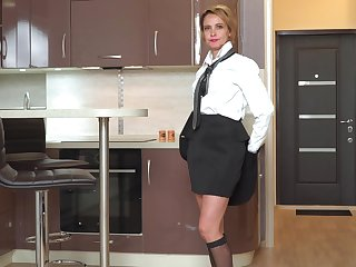 Declaratory Russian woman Oliya is masturbating pussy with respect to the kitchen