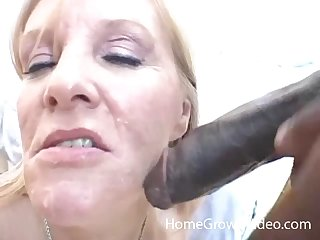 Shallow amateur video of a mature wife sucking a massive black dick