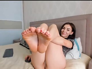 Horny brunette shows say no to feet on webcam