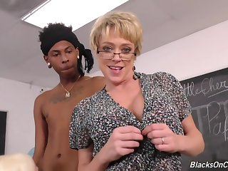 Busty blonde teacher, Alura and their way assistant, Dee are having interracial threesome in the classroom