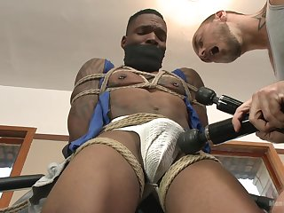 Black hunk endures rough anal and toying in gay BDSM play