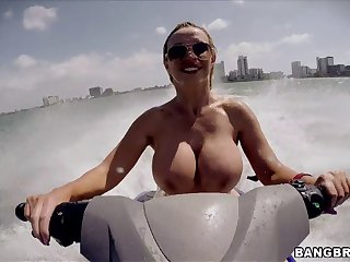 Fake boobs MILF Nikki Benz sucks a dick and gets fucked upon outdoors