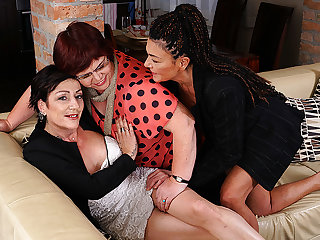 A handful of Mature Lesbians Getting Wet On The Couch - MatureNL